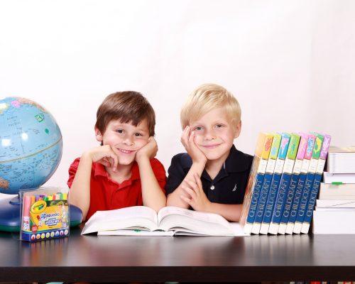 boys behind a desk